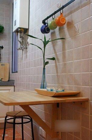 餐桌折叠下来的效果.   厨房台面 鞋柜、酒柜、杂物柜,几柜合一了