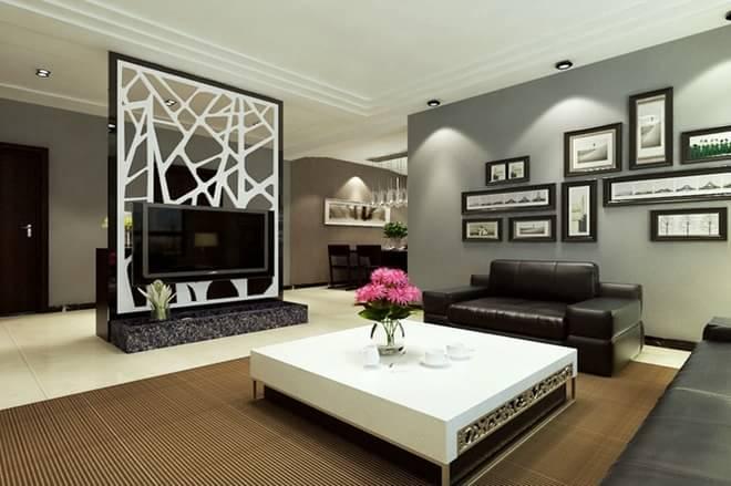客厅的白色木质隔断与灰色大理石和亮黑色不锈钢的强烈对比,给利落的